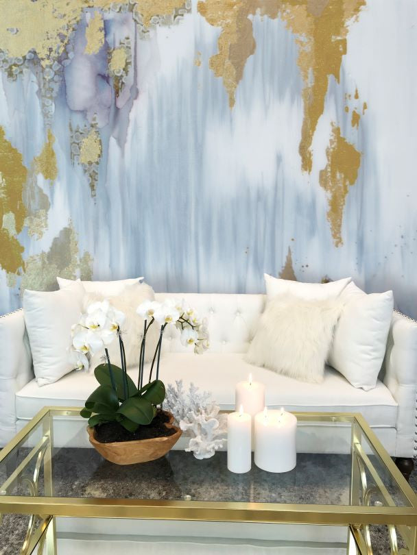 blue gray and gold large wall mural behind white sofa