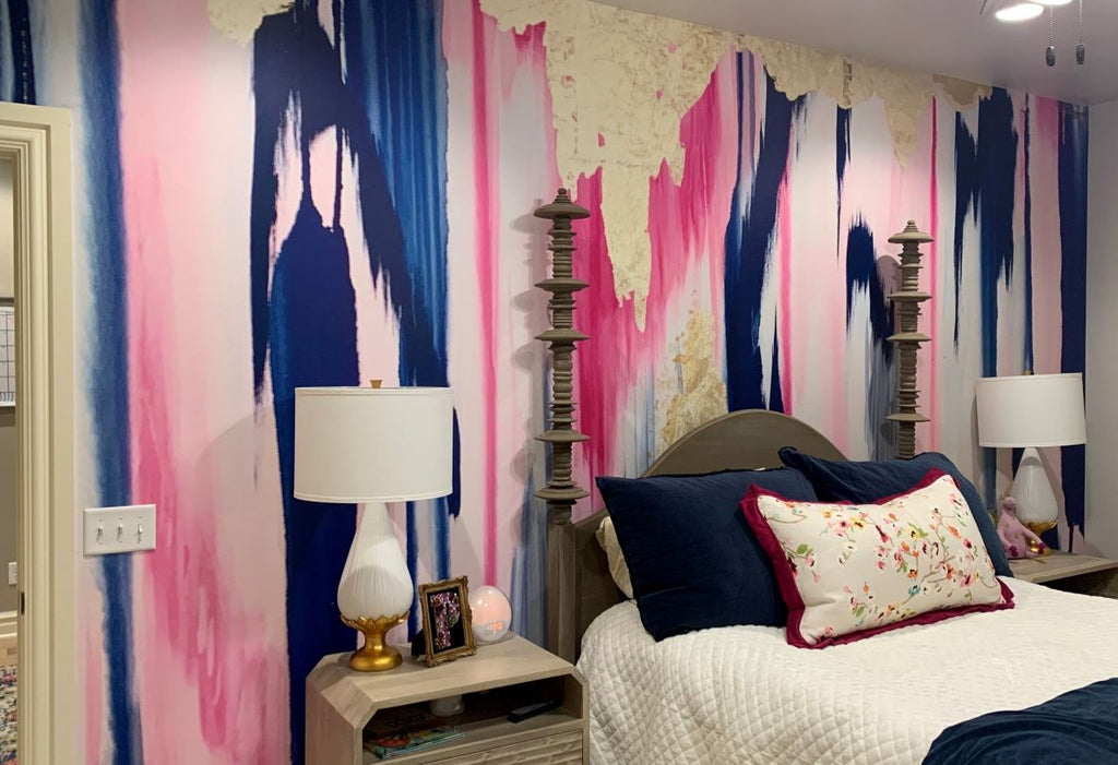 Pink and blue abstract accent wall bedroom