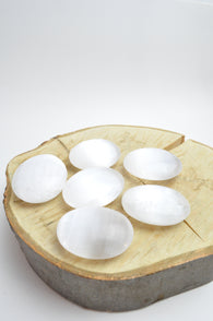 6 Satin Spar Selenite Palm Stones on Wood Block