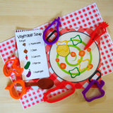 Child's Dough stock pot play mat with vegetable cutters