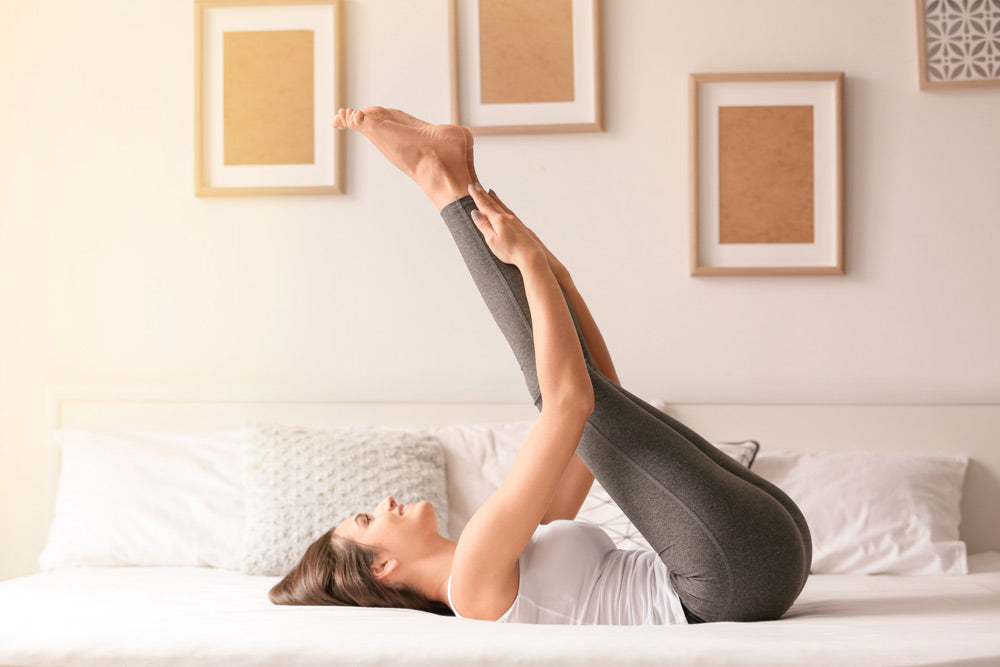 Woman stretching in Puffy Mattress