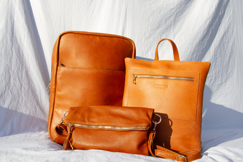 Parker Clay Mother's Day gift guide gold plated collection sustainable leather bags for mom