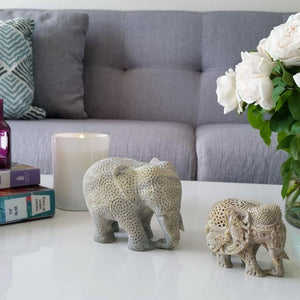 handmade soapstone elephant figurine, styled on a coffee table