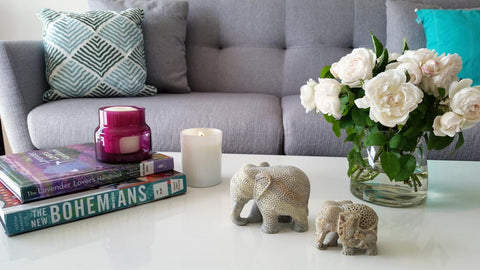 hand-carved soapstone elephants with tealights and flowers