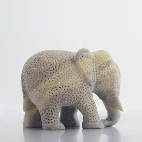 Side profile of intricately hand-carved soapstone elephant.