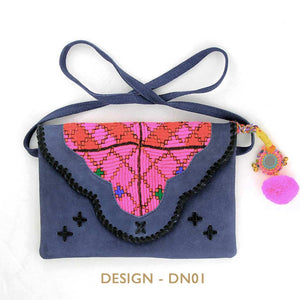 Blue suede leather bag with bohemian embellishments