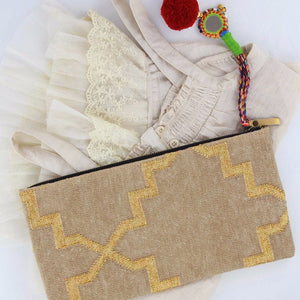 Gold dhurrie clutch styled with lace top