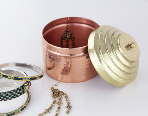 Copper heirloom box with a brass lid, styled with some jewelry