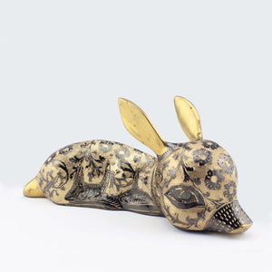 An exquisitely handmade brass fawn, adorned with floral engraving