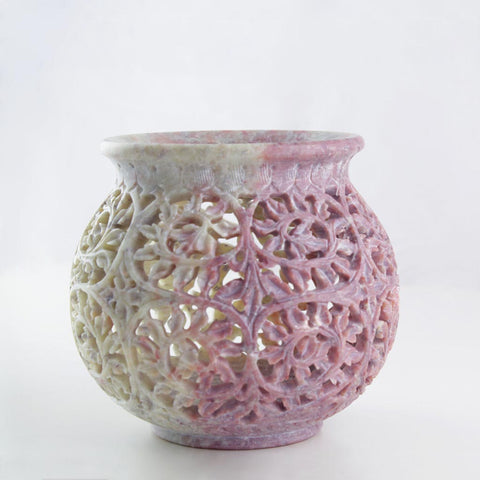 side view of a unique and handmade decorative jar in elegant soapstone
