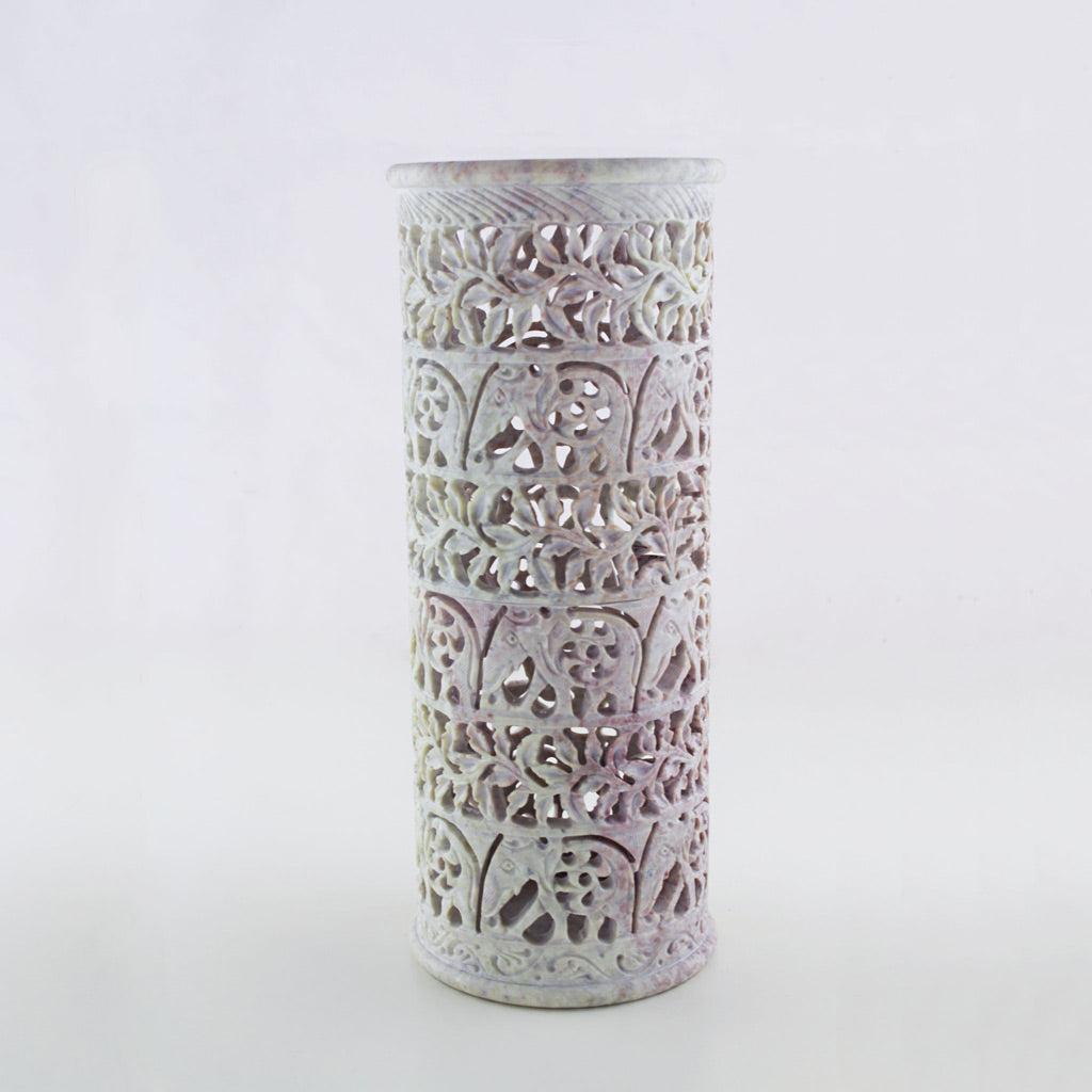 A unique decor item, this cylindrical soapstone vase is beautifully handmade