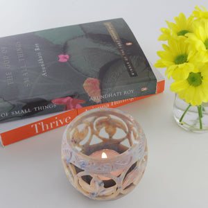 handmade soapstone tealight holder, styled with books and flowers