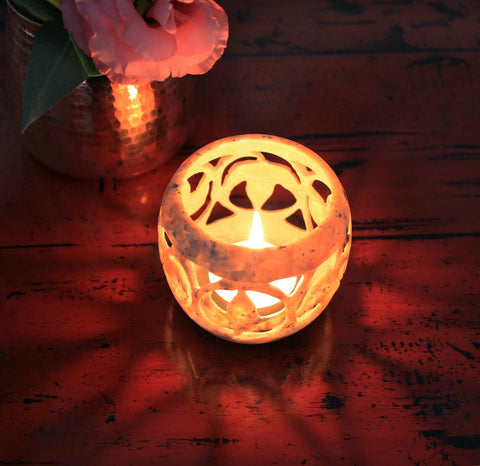 handmade soapstone tealight holder, with a lit candle
