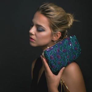 Woman Holding Indian Beaded Clutch - Night Flowers