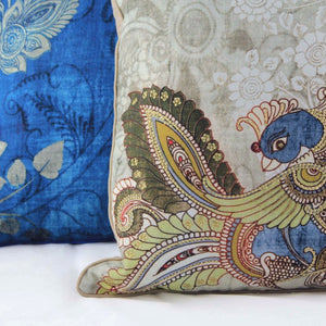 exquisetly embroidered, decorative cushion paired with complimentary blue pillow