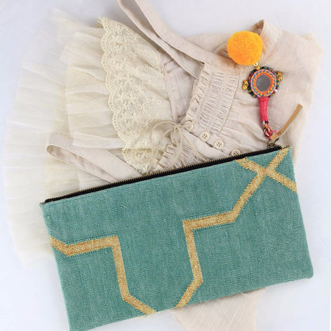 Mint colored bohemian dhurrie clutch styled with lace top
