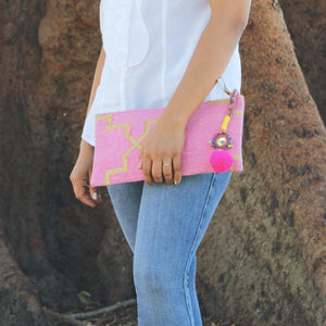 Model with Bohochic Dhurrie Clutch in Pink