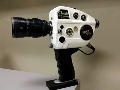 New super 8 camera pistol grip eliminates the old external battery pack.