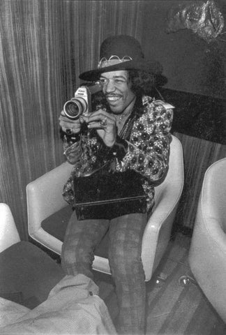 Jimi Hendrix with Canon 814 super 8 camera