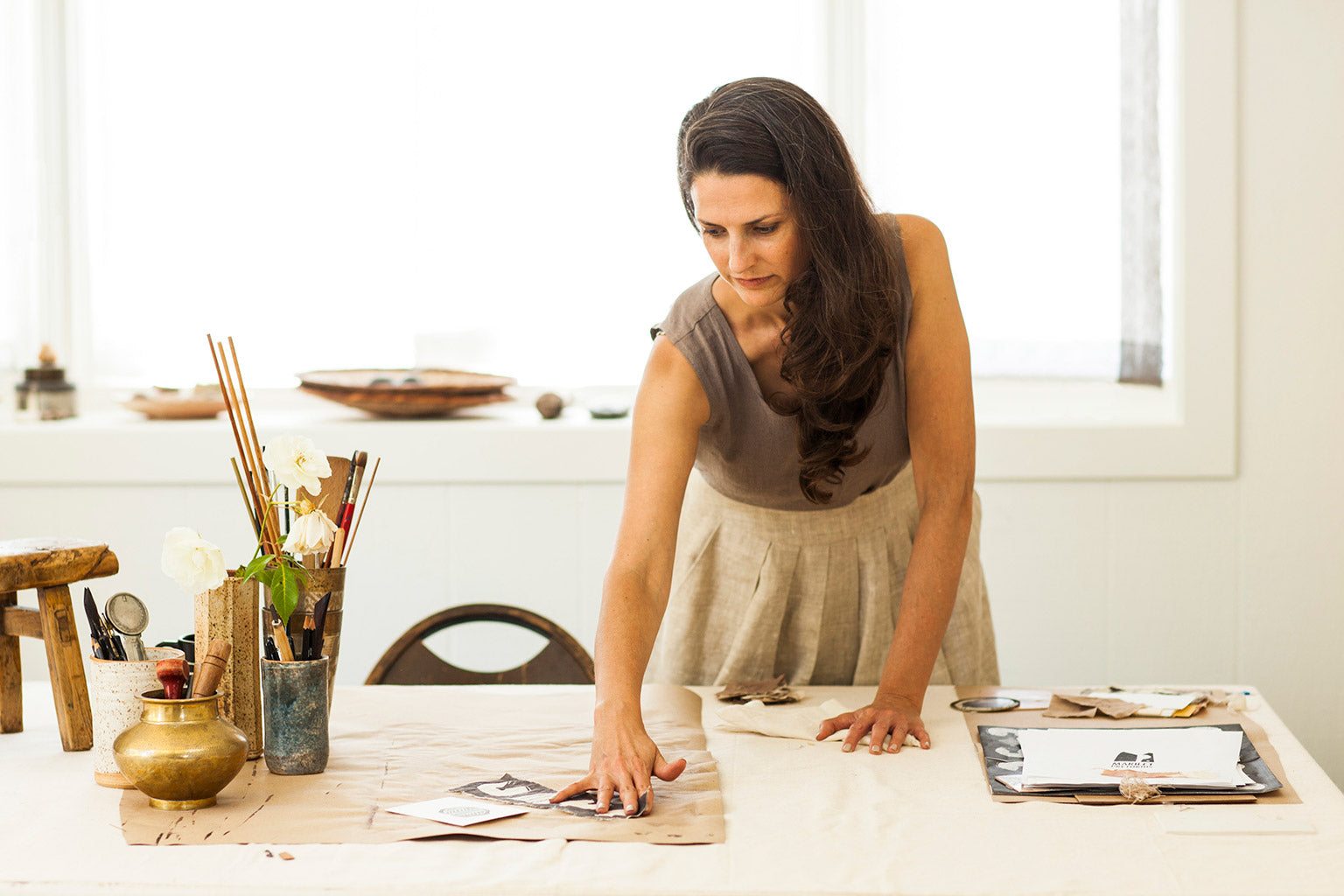 Marilet Pretorius, artist and designer, at work in her studio.
