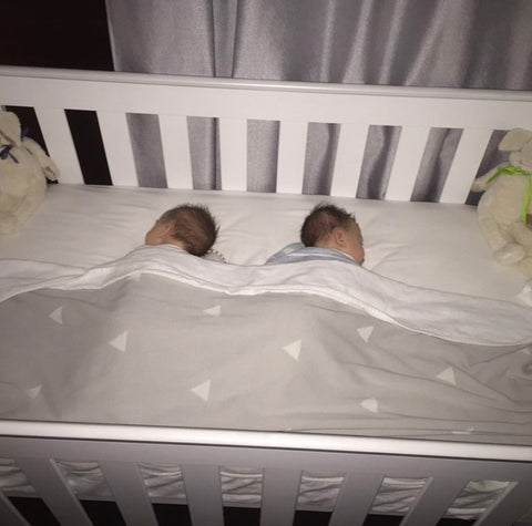 Back when they used to sleep all night, and in the same cot (please no judgment on the fact they are sleeping on their tummies here x)