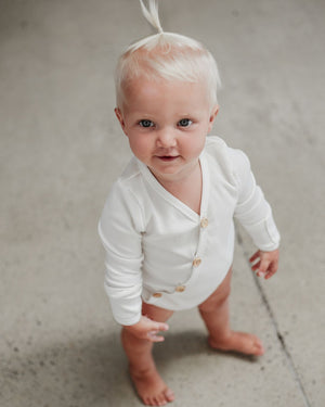 Two Darlings Milk Longsleeve bodysuit available at 2 Little Rascals