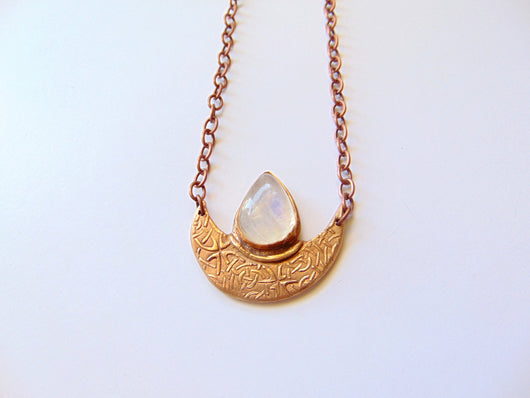 crescent moon bronze necklace with rainbow moonstone