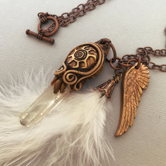 crystal point with bronze angel wing and white feather necklace