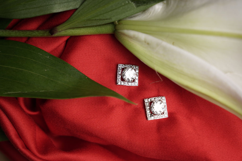rhodium earrings. Square Solitaire studs