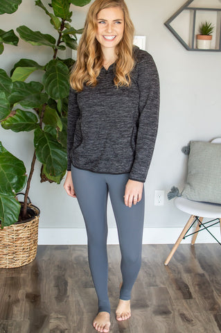 charcoal grey sweater paired with charcoal stirrup leggings