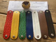 The WoggleMakers Scout Woggle Yellow / 5 Scouting Activity Packs - Unplaited Leather Woggles with instructions.