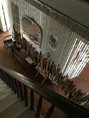 next to the main staircase, piano keys are strung up creating a curtain