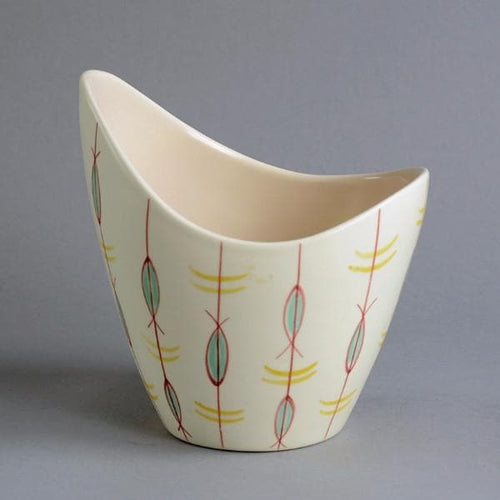 Earthenware contemporary ware bowl with glossy white glaze and decoration by Poole Pottery
