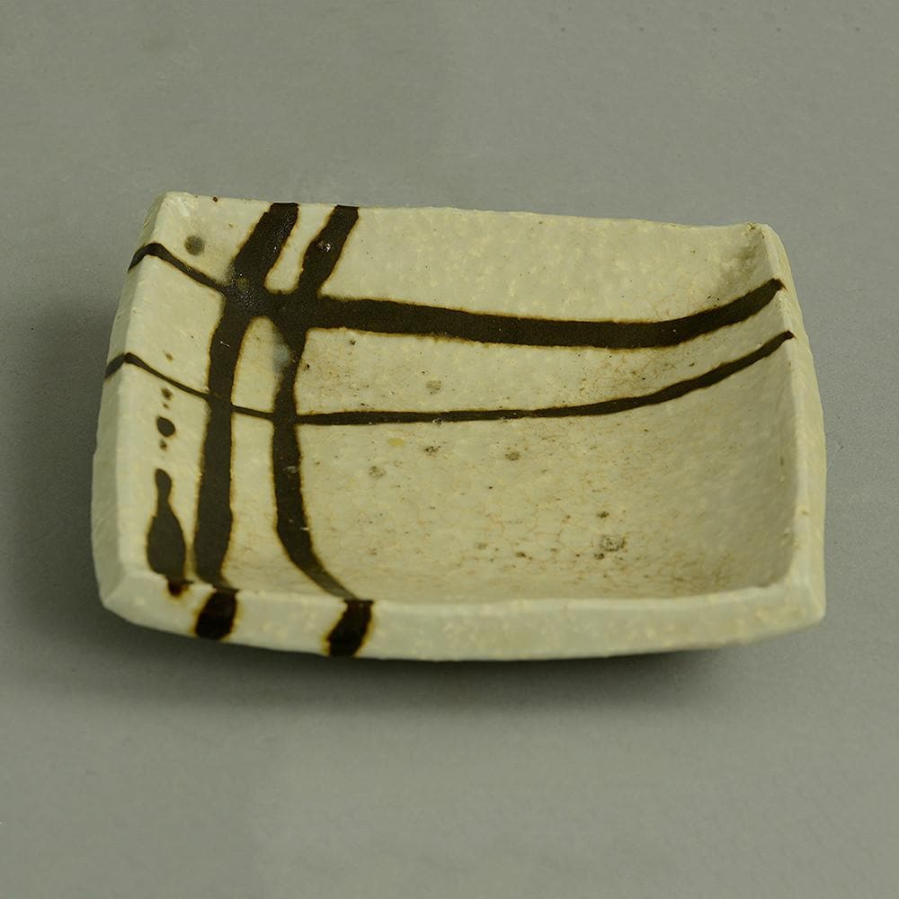 Stoneware chamotte dish with cream and brown glaze by Janet Leach