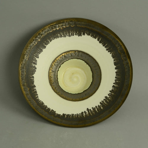 Footed porcelain bowl with matte brown and cream glaze by Peter Wills