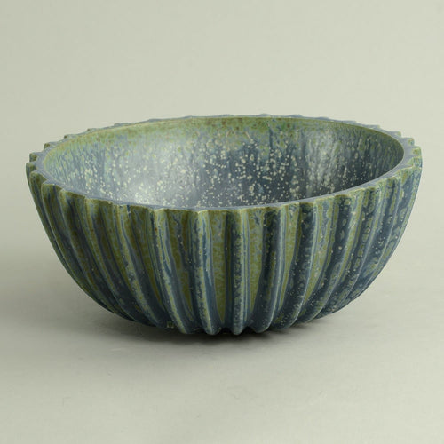 Ribbed stoneware bowl with matte blue crystalline glaze by Arne Bang