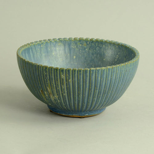 Stoneware fluted bowl with matte blue glaze by Arne Bang