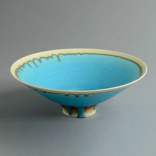 Footed porcelain bowl with blue glaze by Peter Wills