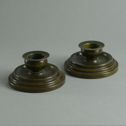 Pair of bronze candlesticks by Argentor
