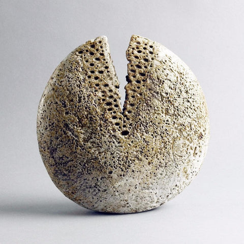Pod form vessel with matte brown glaze by Alan Wallwork