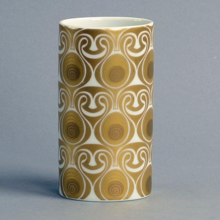 Gold and white porcelain vase by Bjorn Wiinblad