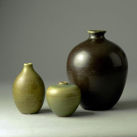 Group of vases with green and black glaze by Tobo