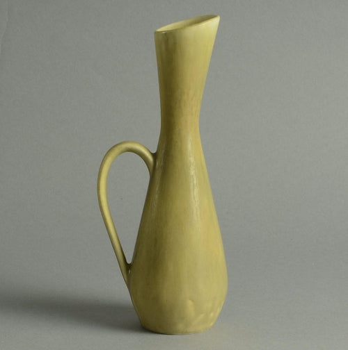 Stoneware pitcher with yellow ochre haresfur glaze by Carl Harry Stålhane N7744
