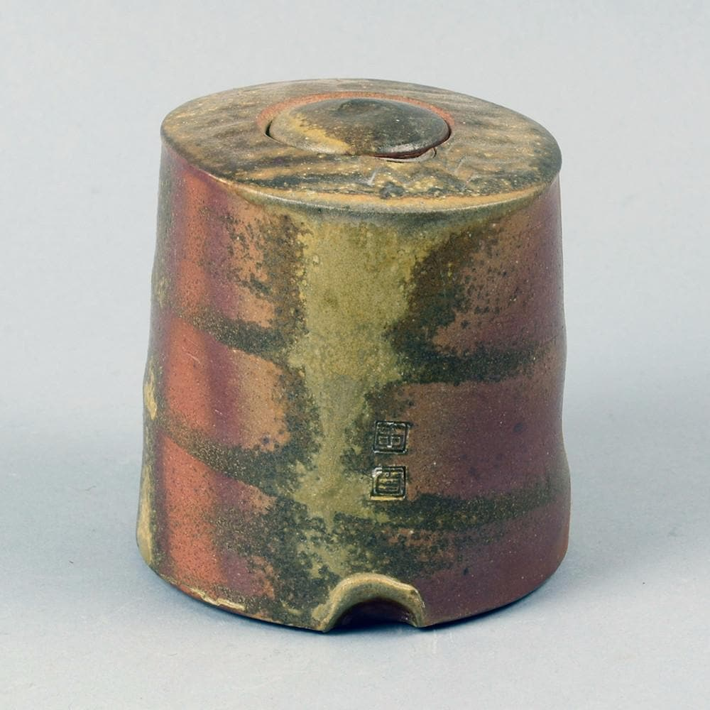 Stoneware jar with brown glaze by Byron Temple