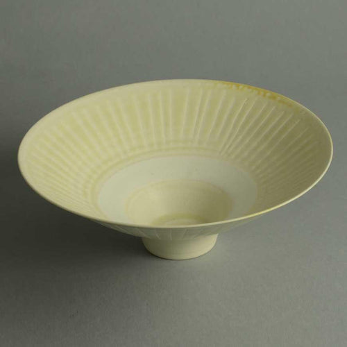 Footed porcelain bowl with matte cream glaze by Peter Wills