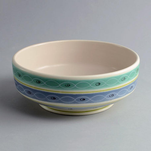 Earthenware bowl with white, purple and green glaze by Poole Pottery