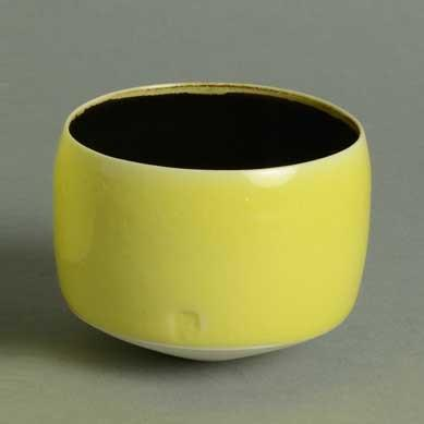 Porcelain bowl with glossy yellow and black glaze by Peter Wills