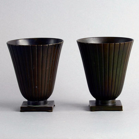 Pair of bronze ribbed footed vases by Just Andersen for GAB