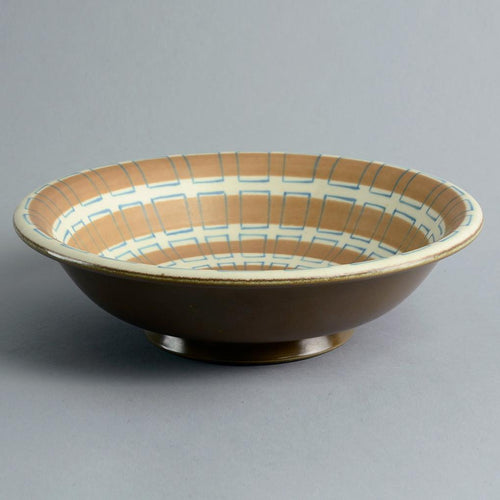 Earthenware freeform bowl with matte white, brown and green glaze by Poole Pottery