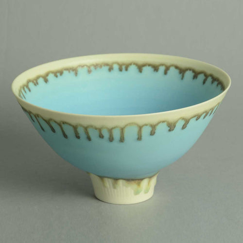 Footed porcelain bowl with matte blue and cream glaze by Peter Wills